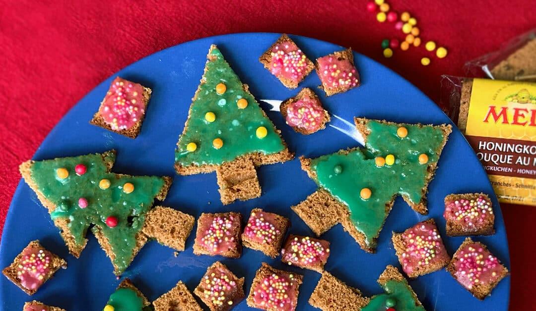 Vrolijke kerstkoekjes met honingkoek